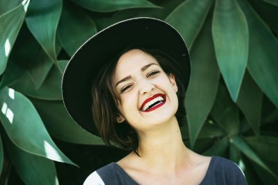 woman smiling showing straight teeth